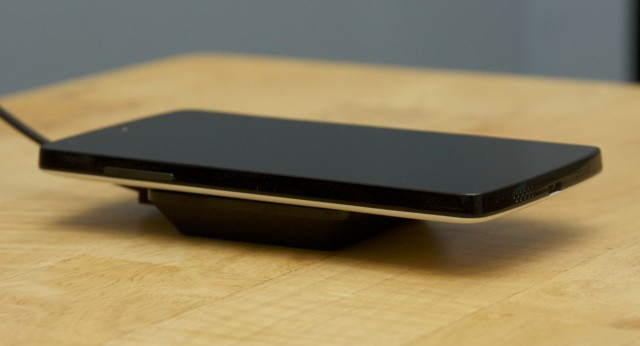 The Qi-compatible Nexus 5 on the Nexus Wireless Charger.