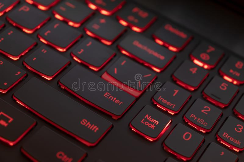 Colorful keyboard for gaming. Backlit keyboard with red color scheme. Colorful light keyboard.  royalty free stock photography