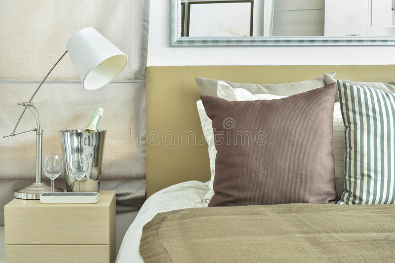 Light brown color scheme bedding with light brown headboard. And table lamp royalty free stock images
