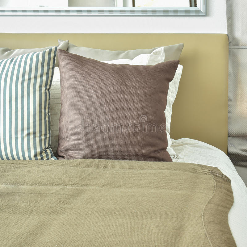 Light brown color scheme bedding with light brown headboard. And table lamp royalty free stock image