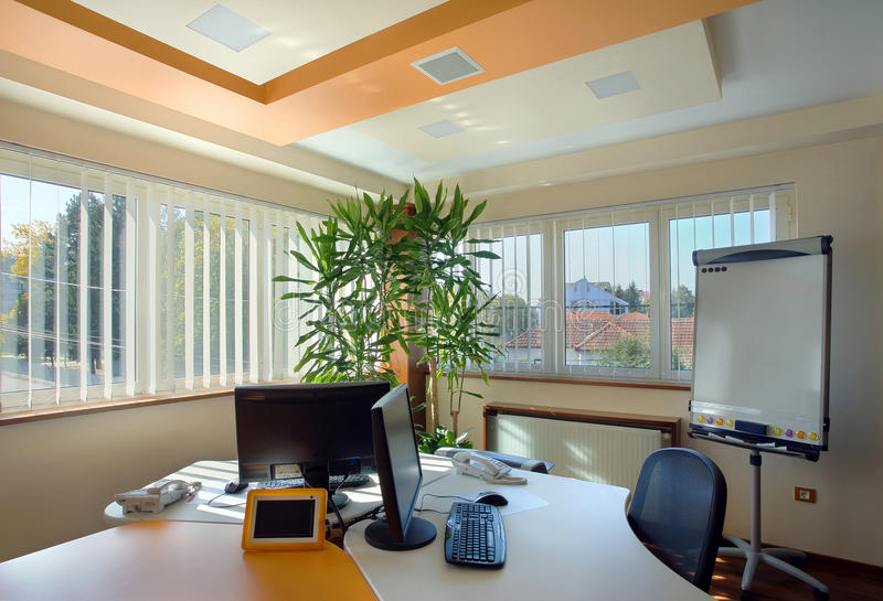 Office interior. Interior of an office, modern and simple furniture and lighting equipment stock photography