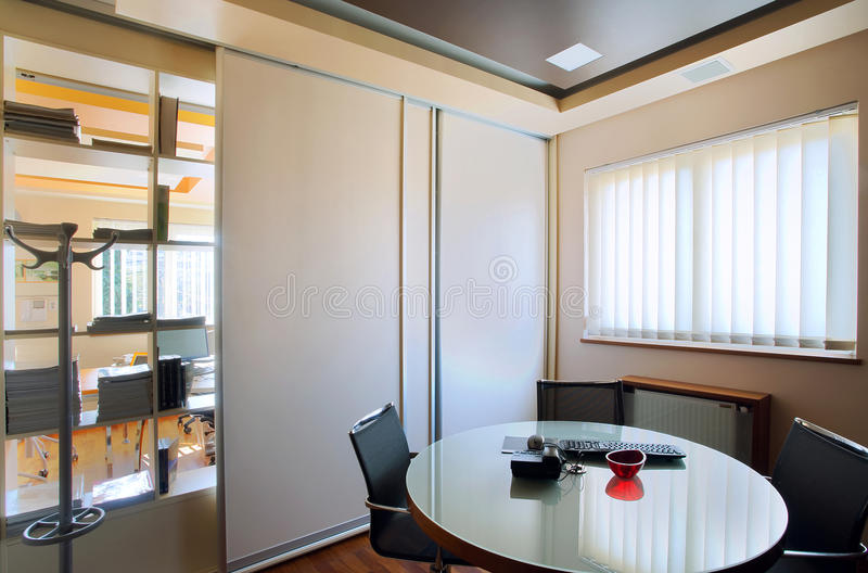 Office interior. Interior of an office, modern and simple furniture and lighting equipment royalty free stock image