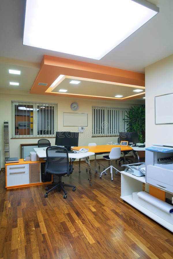 Office interior. Interior of an office, modern and simple furniture and lighting equipment stock photos