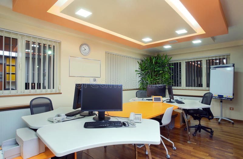 Office interior. Interior of an office, modern and simple furniture and lighting equipment stock images