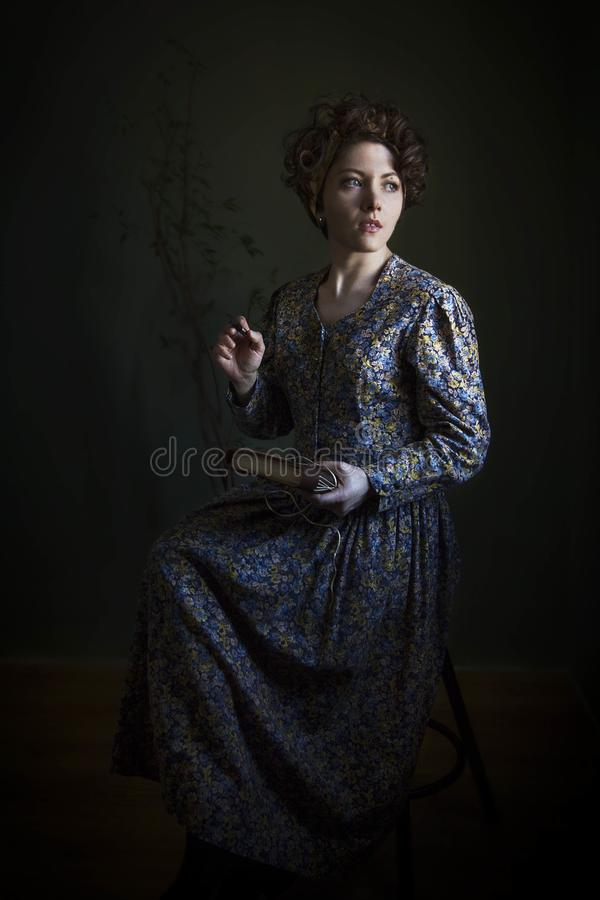 Portrait of a young woman in a beautiful English dress. The light scheme of Rembrandt, where the only light source - light from th. Portrait of a young woman in royalty free stock images