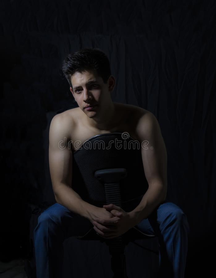 Young model sitting and with a lighting scheme rembrandt. Rembrandt is considered one of the masters of light in painting. His recognition is such that there is royalty free stock image