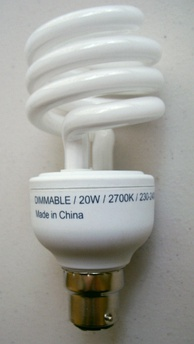 Dimmable integrated helical CFL that dims 2–100%, comparable to standard light bulb dimming properties