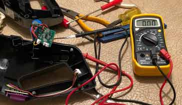 Digital multimeter, DMM in use testing some electronic equipment